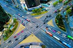 Traffic speeds through an intersection in Gangnam. Stock Photos