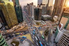 Traffic speeds through an intersection in Gangnam, Seoul in South Korea.  Royalty Free Stock Photo