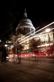 Traffic by St Paul's Cathedral at night. London. Blurred motion of passers-by and traffic Royalty Free Stock Photography
