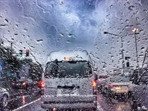 Traffic stands still on a rainy day. With road view through car window with rain drops Royalty Free Stock Image