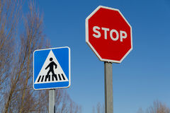 Traffic Stop Signs and Pedestrian Crossing Stock Images
