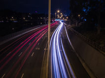 Traffic streaking Down a Highway at Night. Half red, half white Traffic streaking down a highway at night time next to a river Stock Images