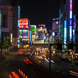 Traffic streams into the Shinjuku district at night in Tokyo, Japan. Shinjuku Tokyo is one of the busiest areas in the world Royalty Free Stock Photo