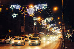 Traffic on street decorated with Christmas stars Stock Photography