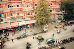 Traffic on a street of historical Pink City with cars Royalty Free Stock Photography