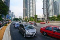 Traffic on street nearby Petronas Twin Towers in Kuala Lumpur Royalty Free Stock Photography