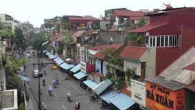 Traffic in a street of an old part of Hanoi, Vietnam stock footage