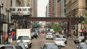 Traffic on the Streets of Chicago Downtown. Crowded Chicago city center of vehicles and pedestrians stock video