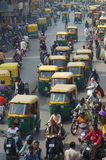 Traffic on streets of India. Traffic with rickshaw, motorbikes, cycles in the streets of ahmedabad, India royalty free stock photo
