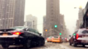 Traffic on the Streets of New York in a Snow Storm. Traffic moving through clogged streets of Manhattan during a snow storm in New York City stock video footage