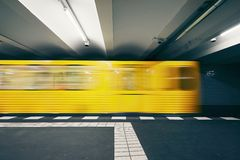 Traffic in subway. Blurred motion of the train in underground station of subway. Berlin, Germany Royalty Free Stock Photos