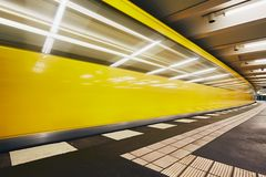 Traffic in subway. Blurred motion of the train in underground station of subway. Berlin, Germany Stock Images