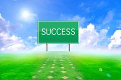 Traffic success sign and green background Royalty Free Stock Photos
