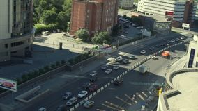 Traffic in Sunny Day. Lots of Cars Driving Near Some Buildings at the Sunny Day stock video footage