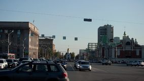Timelapse of the evening city. The traffic on the roads of Novosibirsk, Russia. Traffic on a sunny evening in Novosibirsk, Russia. Chapel view. Timelapse stock video