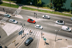 Traffic during sunny summer day on the boulevard de la Ligne. Royalty Free Stock Images