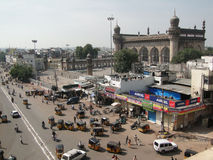Traffic surrounds the Charminar Stock Photo