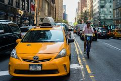 Traffic, taxi and cyclist in NYC stock images