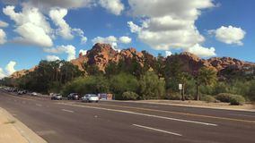 Traffic on 44th St and Camelback Rd with famous Camelback Mtn in background. Phoenix,Az/USA -10.3.2018: Traffic on 44th St and Camelback Rd with famous stock video