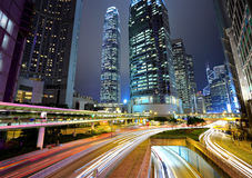 Traffic though city at night Royalty Free Stock Images