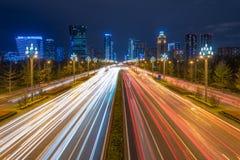 Traffic on Tianfu avenue at night in Chengdu. Chengdu, Sichuan province, China - Sept 27, 2018: Traffic light trails on Tianfu avenue at night with illuminated stock images