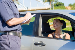 Traffic ticket. Female driver begging traffic police not to write a ticket Stock Images