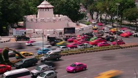 TRAFFIC TIME LAPSE: Bangkok  - High angle MS traffic passing old colonial fort stock video footage