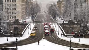 Traffic time lapse during a snow storm in Munich, Germany. Traffic time lapse on prince regent street during a snow storm in Munich, Germany stock video