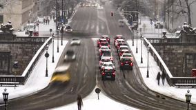 Traffic time lapse during a snow storm in Munich, Germany. Traffic time lapse on prince regent street during a snow storm in Munich, Germany stock video footage