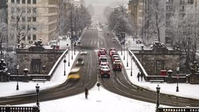 Traffic time lapse during a snow storm in Munich, Germany. Traffic time lapse on prince regent street during a snow storm in Munich, Germany stock footage