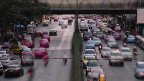 TRAFFIC TIME LAPSE:  Superb telephoto two lane road with pedestrian walkway. Telephoto two lane road with pedestrian walkway (one of a series); scene is from stock video