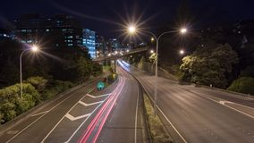 Traffic time lapse Wellington. Light streaks of cars, trucks and motorcycles traveling in and out of wellington city new zealand stock footage