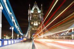Traffic on Tower bridge at night. London, England Stock Photo