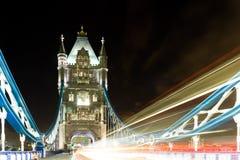 Traffic on Tower bridge at night Stock Images