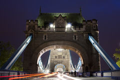 Traffic on The Tower Bridge at night in London, UK Stock Photo