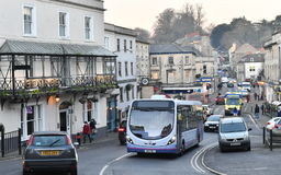 Traffic on Town Road. Frome, UK - January 5, 2017: Traffic makes its way along a busy road in the town centre. The Somerset town near the historic City of Bath Royalty Free Stock Photos