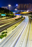 Traffic trail on highway Stock Images