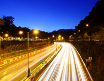 Traffic trail on highway Stock Photos