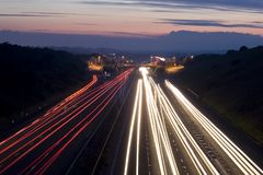 Traffic trails. A section of motorway at night showing light trails from cars Stock Images