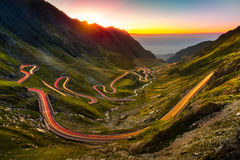 Traffic trails on Transfagarasan pass. At sunset. Crossing Carpathian mountains in Romania, Transfagarasan is one of the most spectacular mountain roads in the Royalty Free Stock Photos
