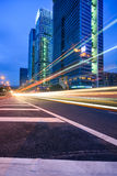 Traffic trails at twilight on the  cityscape background Stock Images