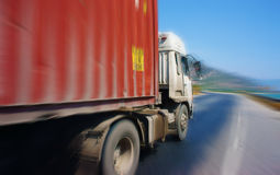 Traffic of transport vehicle on highway 1A. NINH THUAN, VIETNAM- JAN 22: Traffic of transport vehicle on highway 1A, the asphalt road under blue sky, truck Stock Photography