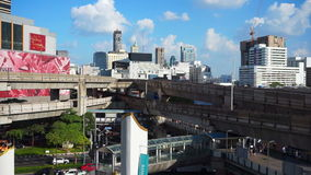 Traffic transportation in Bangkok downtown MBK area. Car, motorcycle and BTS sky train junction f stock video footage