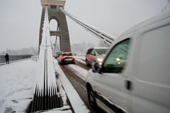 Traffic trying to cross Clifton Suspension bridge. Clifton, Bristol, UK - January 18, 2013: People struggle to get to work given heavy amounts of snowfall. The Stock Photo