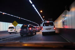 Transit traffic in tunnel. Commuter traffic on Sydneys streets; left-hand driving through the Lane Cove tunnel Stock Image