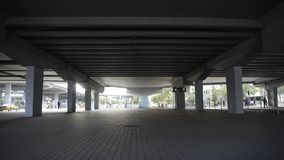 Traffic under overpass in city. stock video