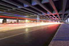 Traffic under the viaduct Stock Photography