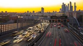 Traffic on urban thoroughfare  in dusk, time lapse. Traffic on urban thoroughfare  in dusk stock video footage