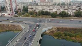 Traffic of vehicles across the bridge. Aerial shot. stock footage