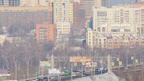 Traffic of vehicles at the Communal Bridge. NOVOSIBIRSK, RUSSIAN FEDERATION - JANUARY 3, 2016: Novosibirsk Panorama overlooks the Communal Bridge frosty January stock video